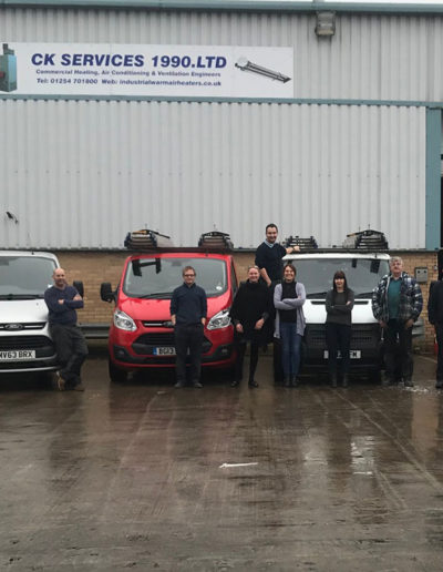 Current fleet of vans pictured with some of the team pictured outside our Blackburn factory.